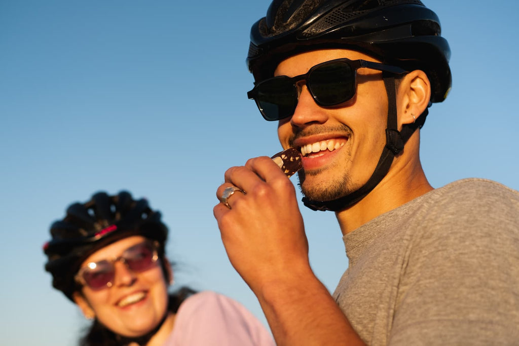 Eating energy bar with cycling helmet