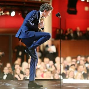 Eddie Redmayne wearing his Duke & Dexters collecting his Oscar, bowler black loafers