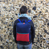 Neoprene and recycled leather backpack