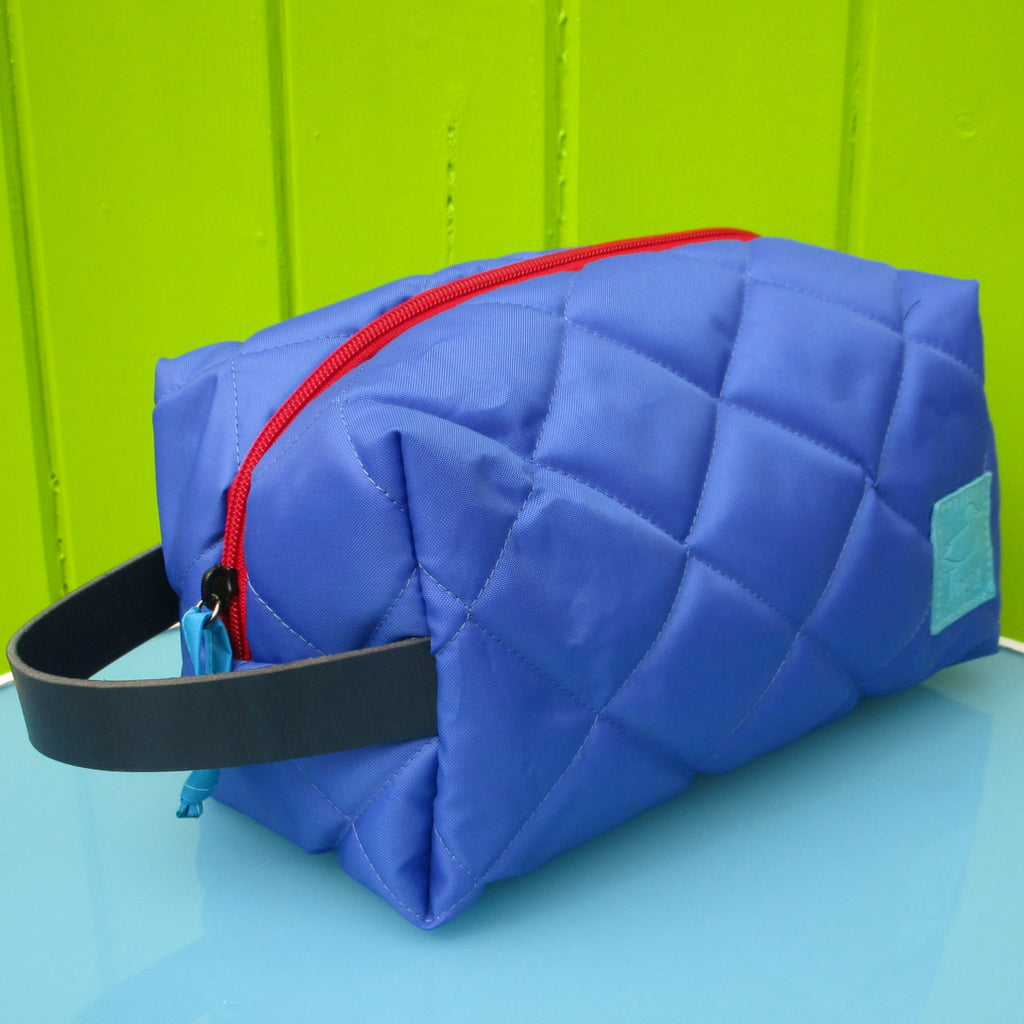 quilted waterproof washbag with leather handle
