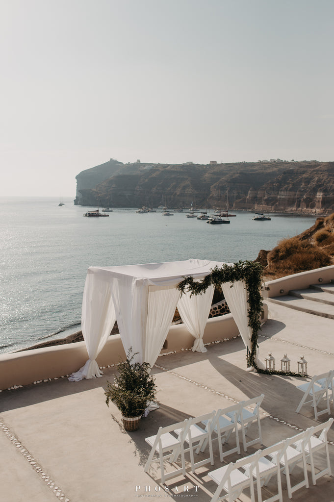Beach wedding venue setting in Santorini Greece