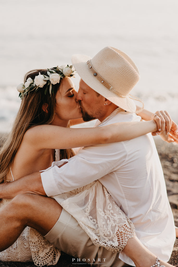 newly weds kissing on the beach