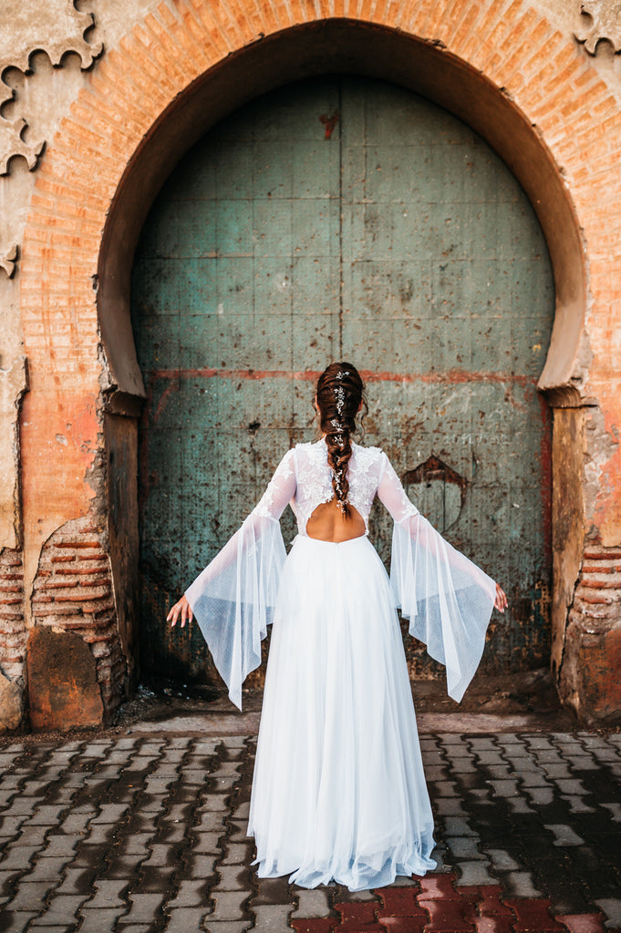 Hippie bride with long white dreamy wedding dress in Morocco