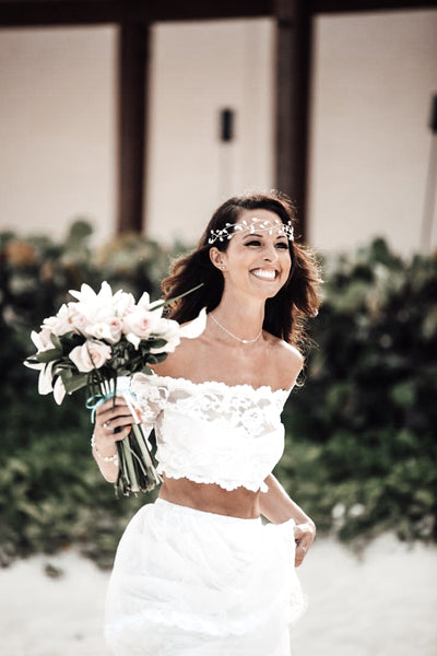 beach bride wearing two piece lace dress