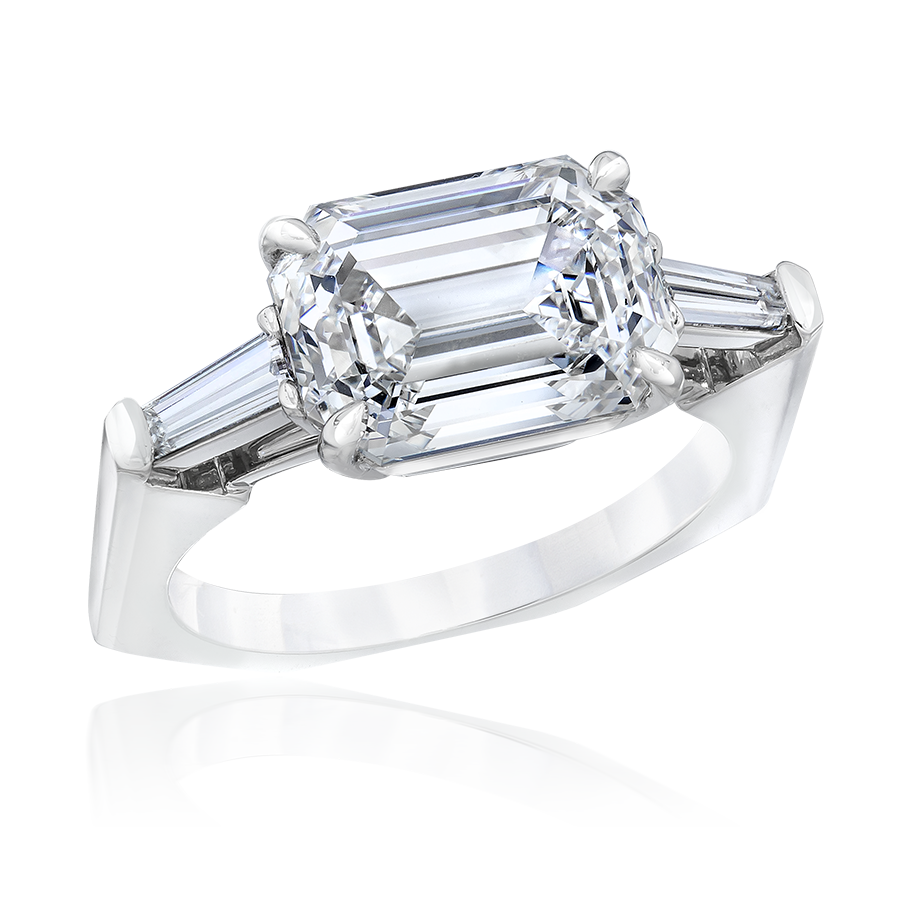 GIA certified, ethically sourced engagement ring with an emerald cut diamond flanked by baguette cut diamonds.