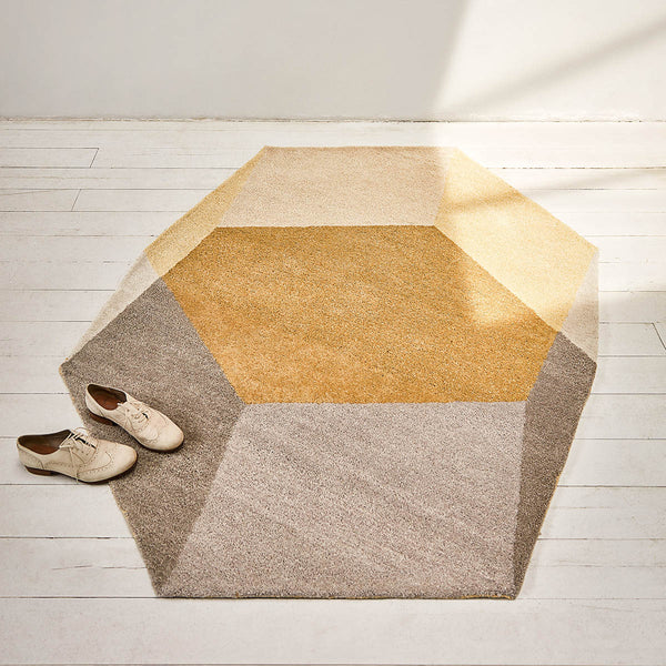 Yellow Isometric Hexagon Rug Design on a wooden floor by PUIK