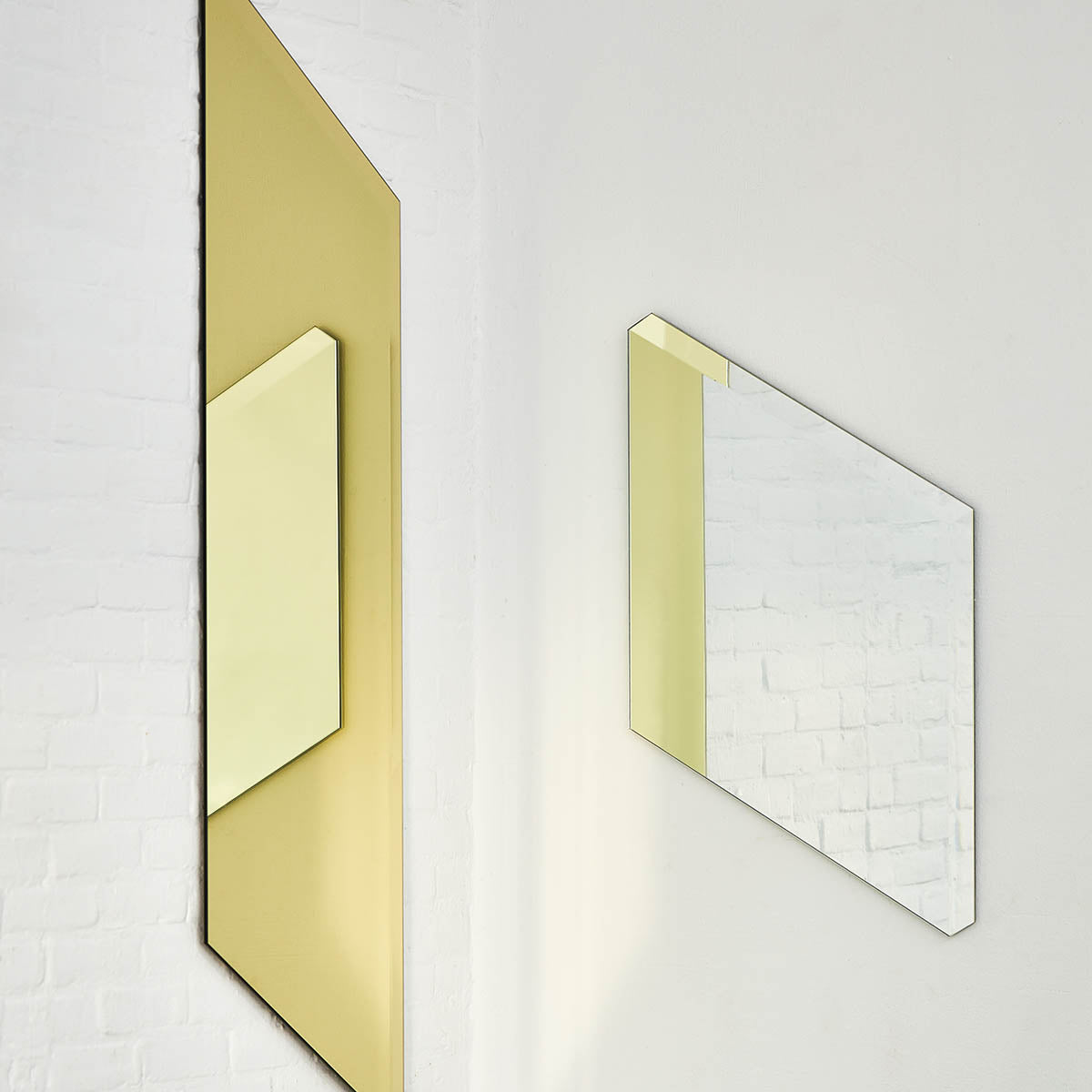Contemporary geometric wall mirror in gold + silver