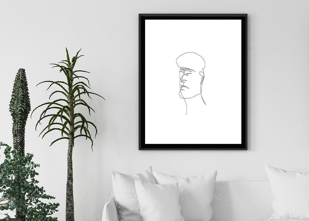 Framed The Head (White) Art Print On A White Wall With Plants