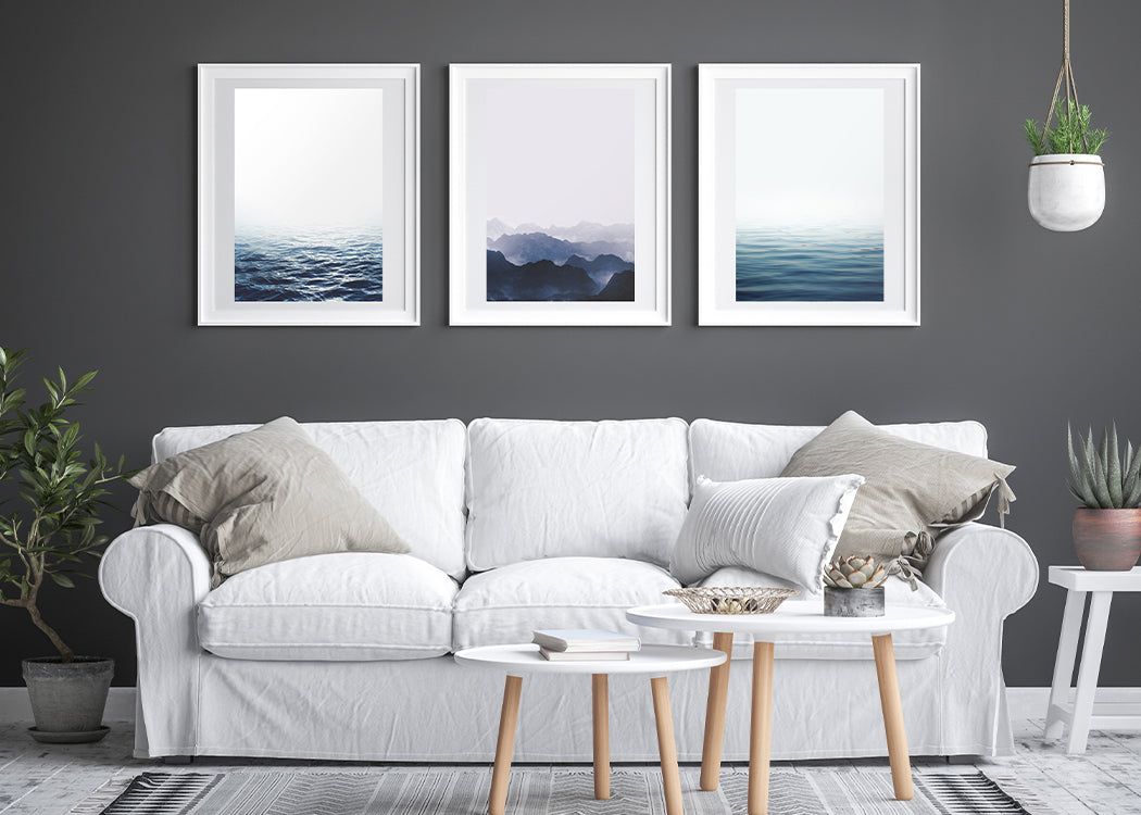 Framed Calm Lake Art Print With 3 Other Framed Prints And Sofa