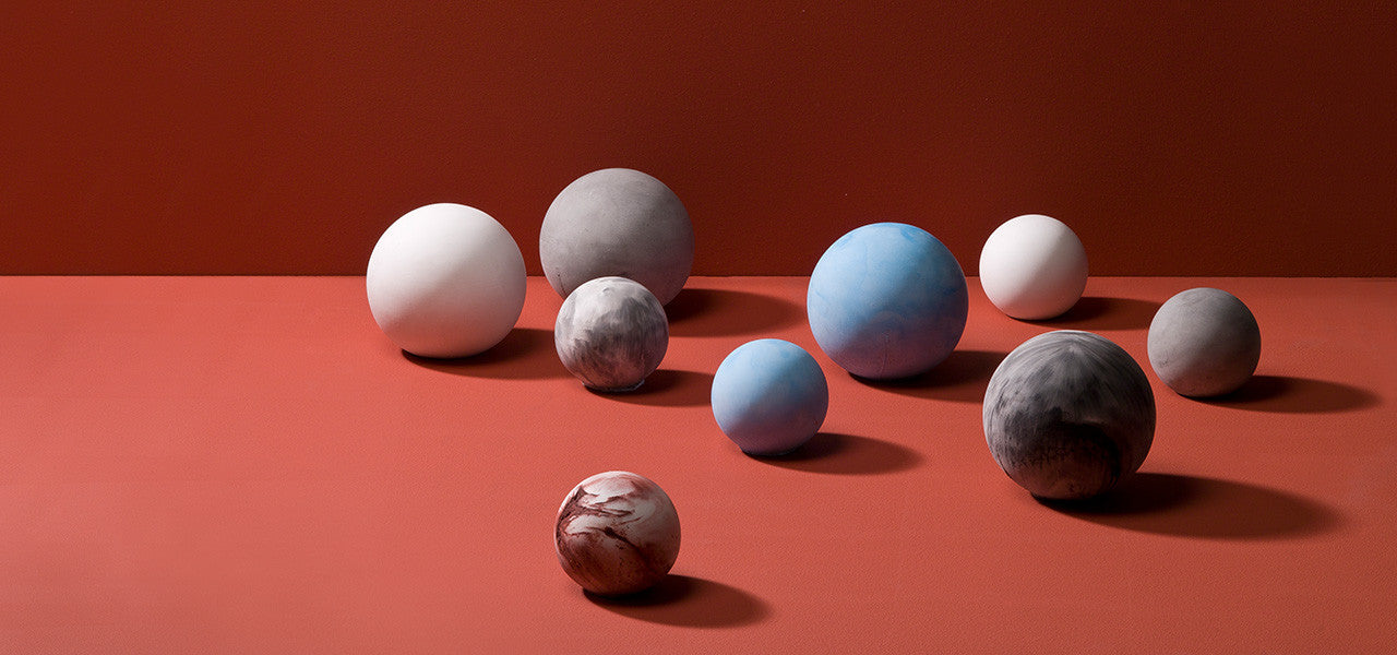 Concrete Planet Paperweights by Korridor Design for MOXON