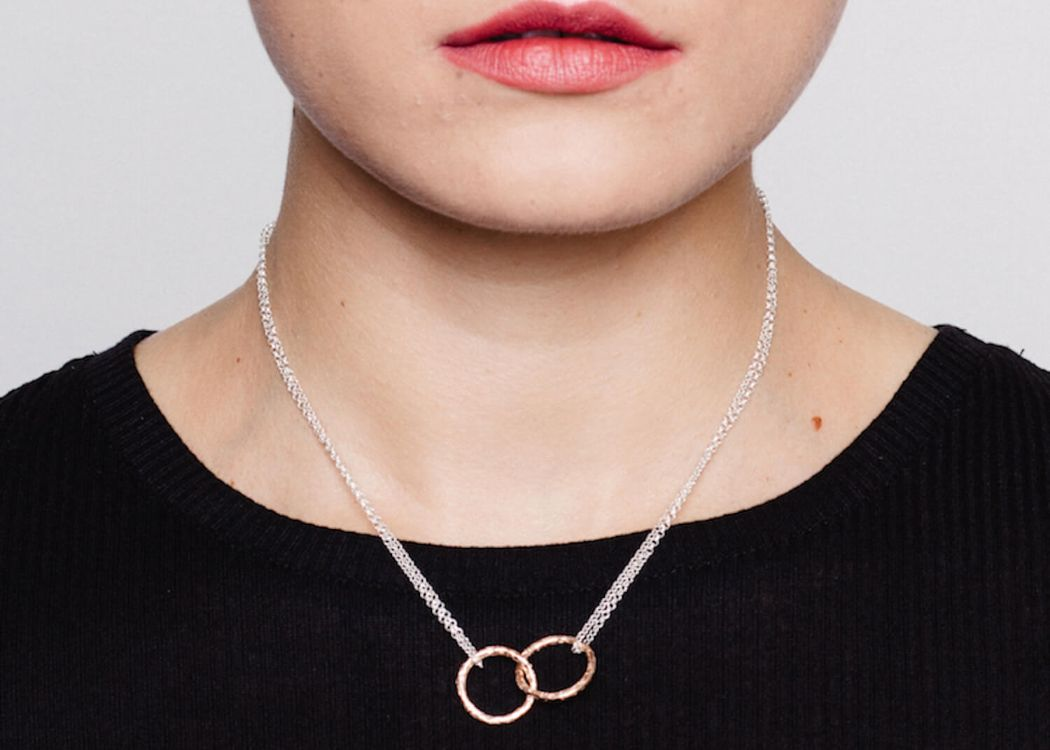 Meteorite Silver and Rose gold necklace by Matthew Calvin as shown on a model