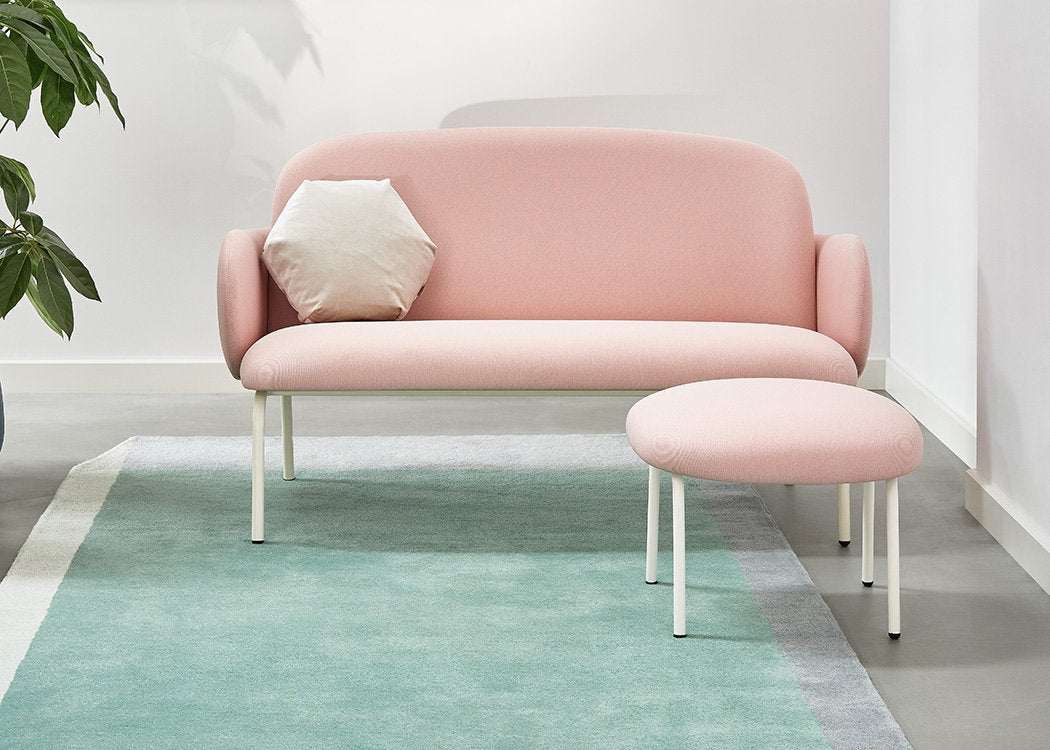 Dost sofa in pink lifestyle image with a footstool