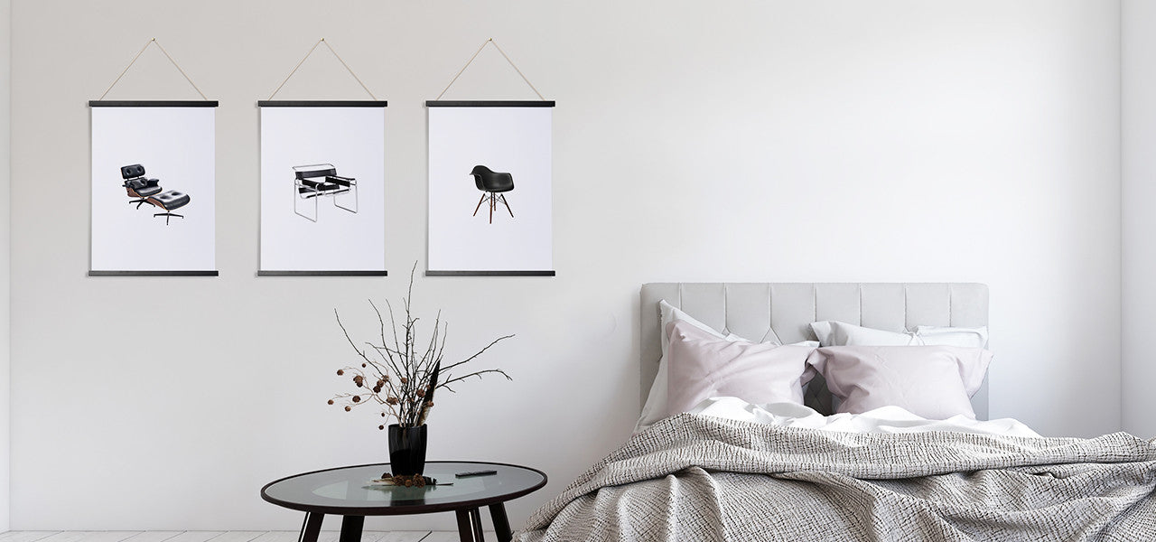 Magnetic Poster Frames with designer chair prints on a bedroom wall