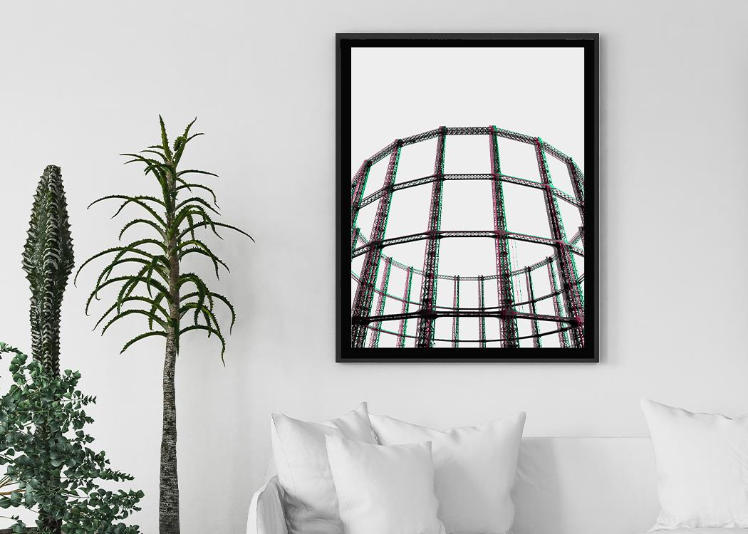 Oval Space Framed Modern Art Print on a white wall with a plant