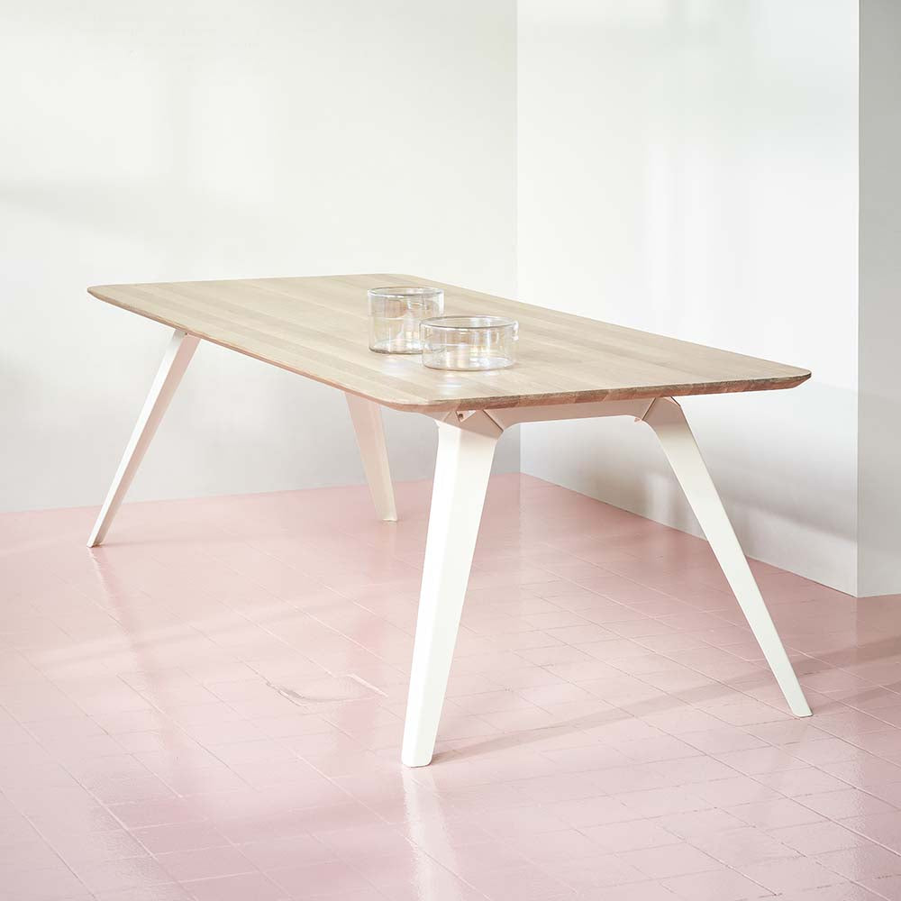 Puik Fold Solid Oak table with white steel frame on a pink tiled floor