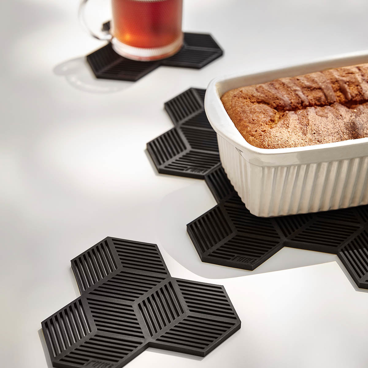 Fun and playful geometric trivets to protect surfaces from hot pots