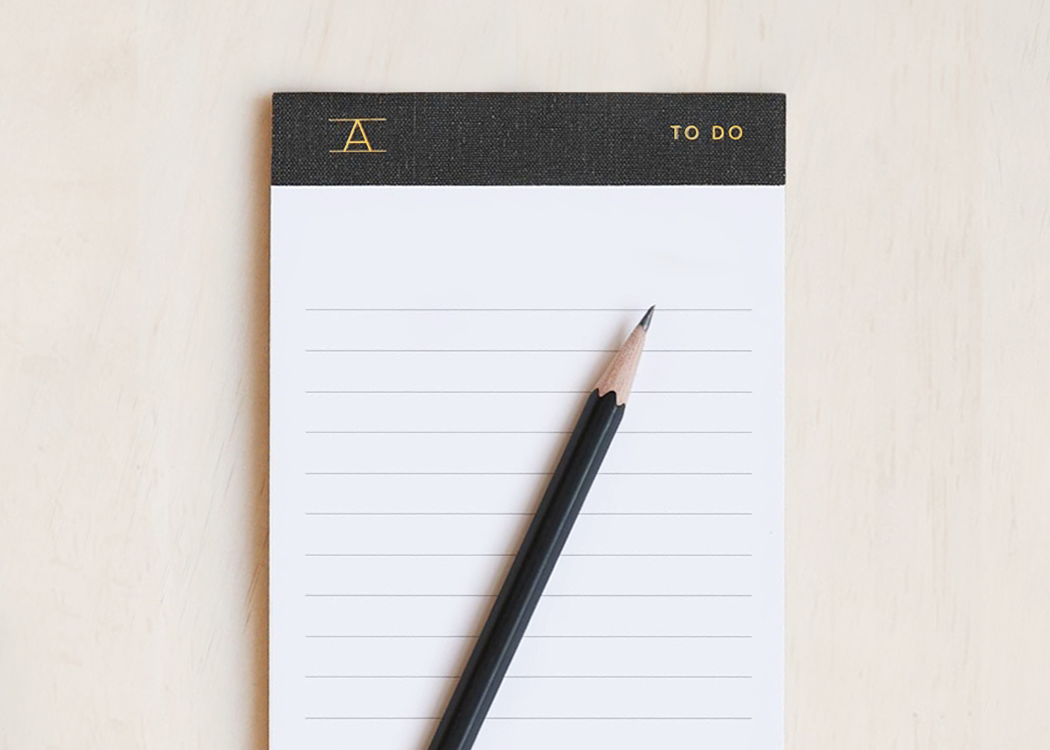 To-do pad by Appointed, with a pencil. Gold foil stamp on the top of the organiser.