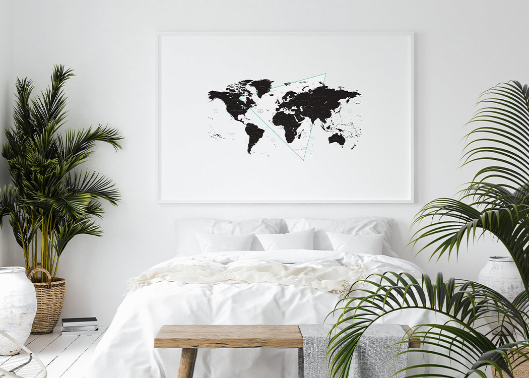 Framed World Map Art Print In A White Bedroom With Plants
