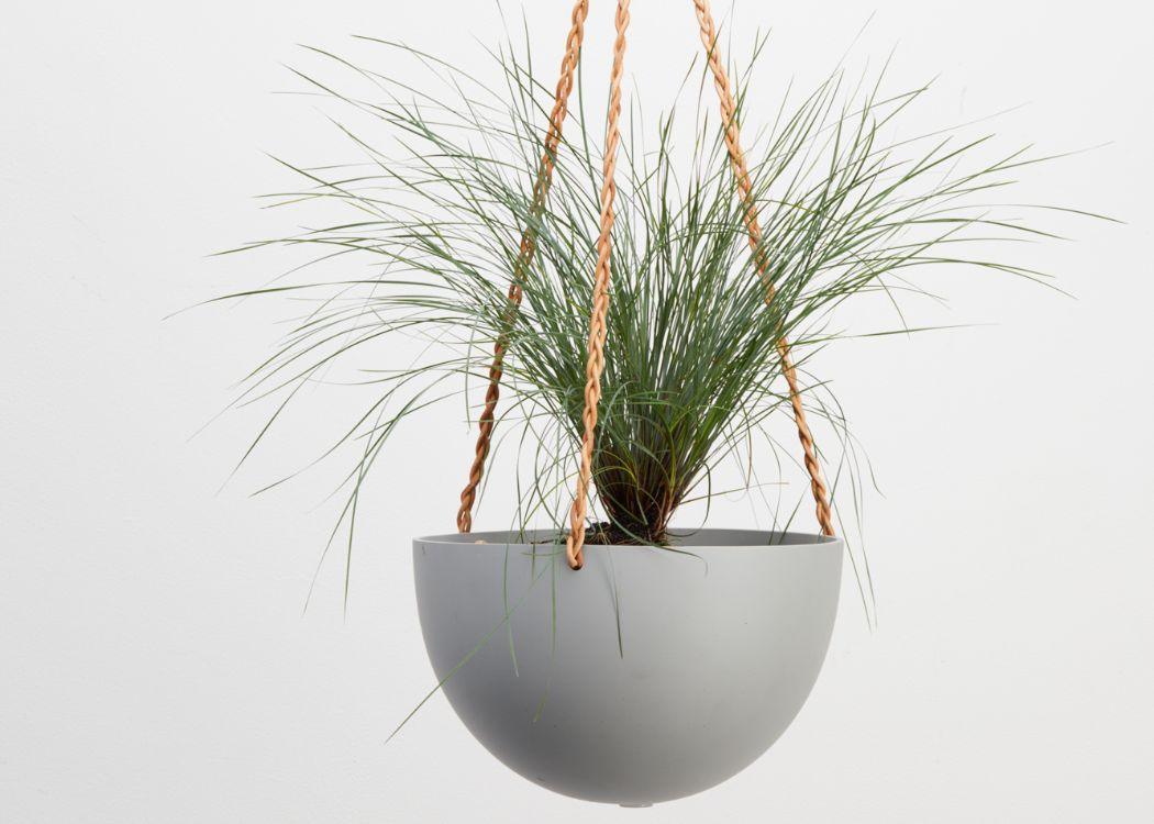 The STONE BLOCK COLOR DOME HANGING PLANTER IS SKILLFULLY HAND MADE FROM RESIN AND FINISHED WITH TAN LEATHER The planter has a hole in the bottom for drainage and a plug for convenience. Designed in Australia. Worldwide shipping. Free UK shipping.