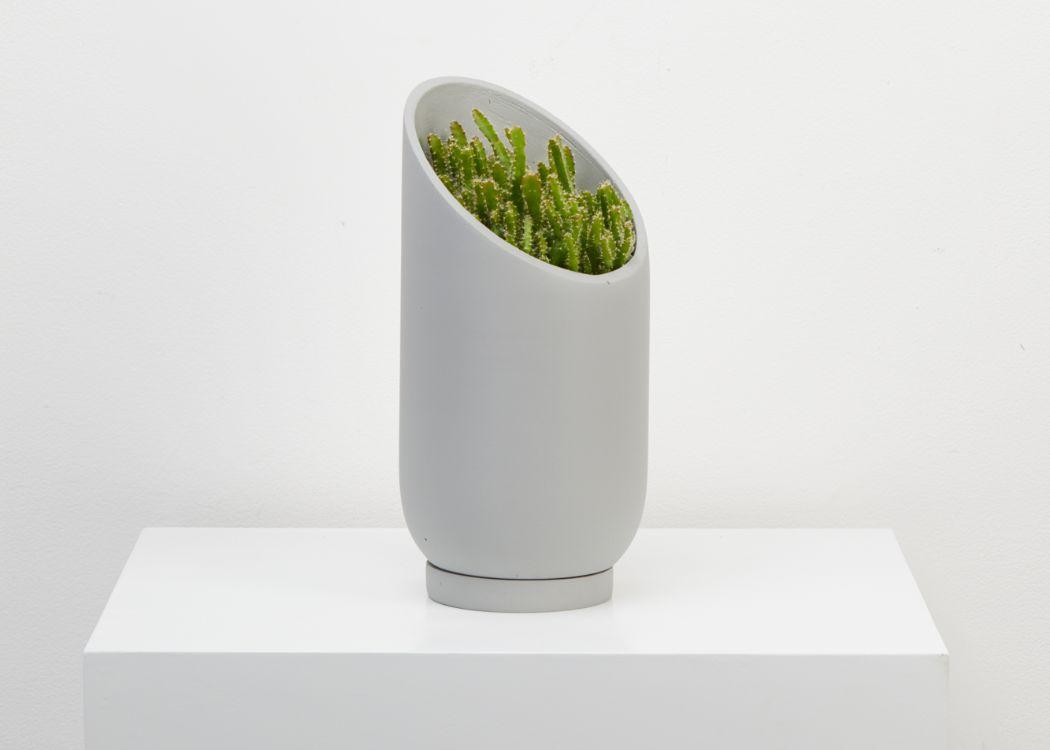 THE SMALL SUMMIT PLANTER HAS BEEN DESIGNED TO PROVIDE AN ORIGINAL BACKDROP FOR YOUR PLANTS. Perfectly suitable for cascading foliage to reveal the resin at the back. The sculptural sliced silhouette creates a unique planter you can angle in any directions, depending on how much light your plant needs. It comes with a tray. 3 colours available. We ship worldwide. Free UK shipping over £30