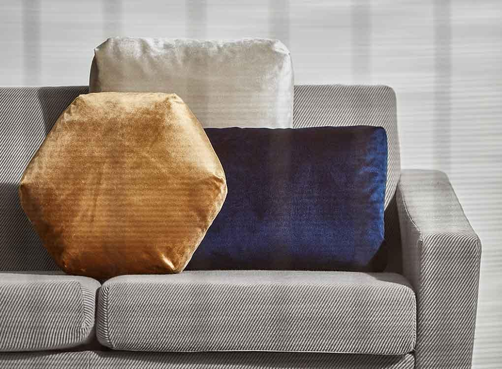 Gold hexagon, rectangle navy and white square velvet Plus Cushions on couch