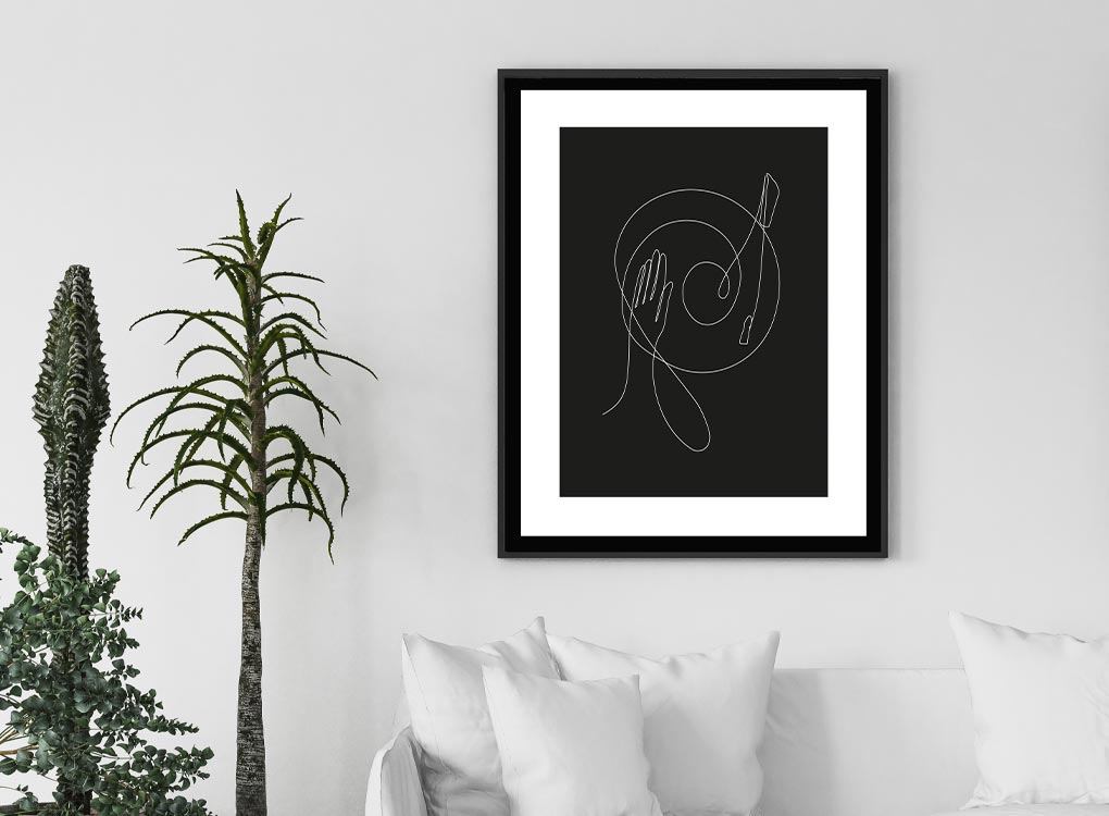 DJ line black and white contemporary art prints hung above sofa with plant