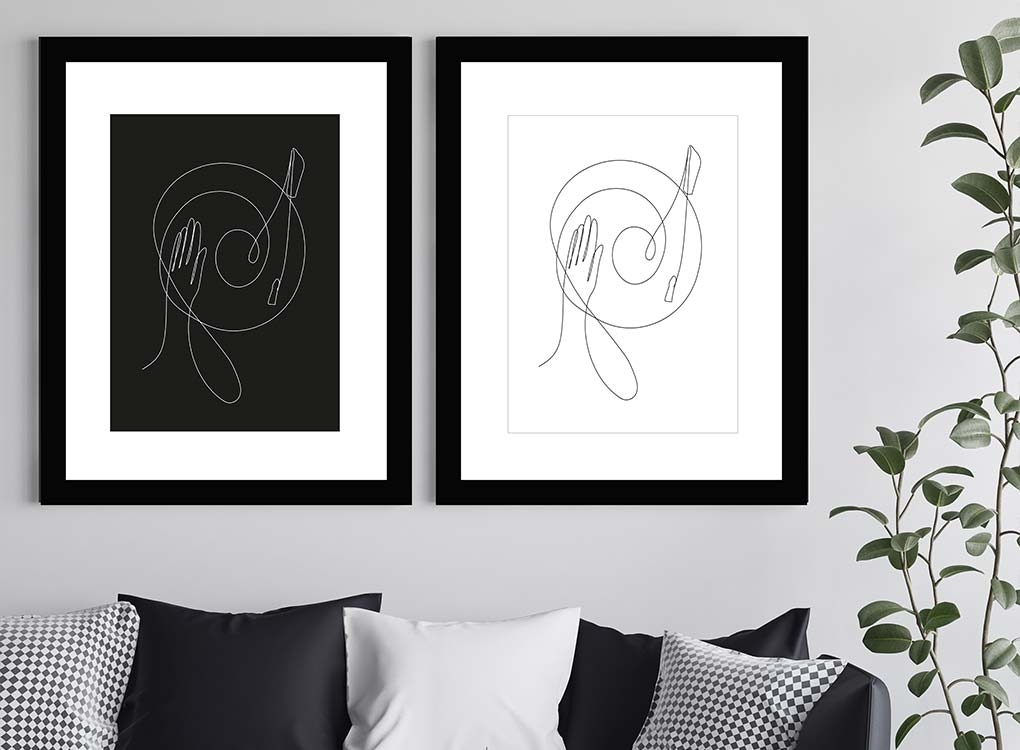 Dj black and white contemporary art prints hung in black wooden frames above sofa with plant