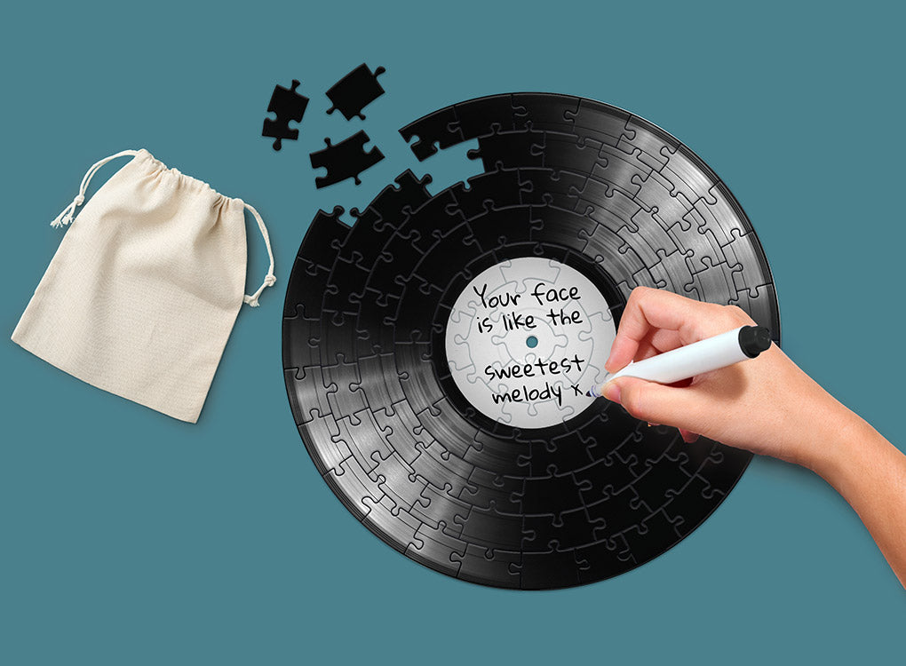 """Pikkii 12"""" vinyl record jigsaw puzzle with someone writing on it, personalising it"""