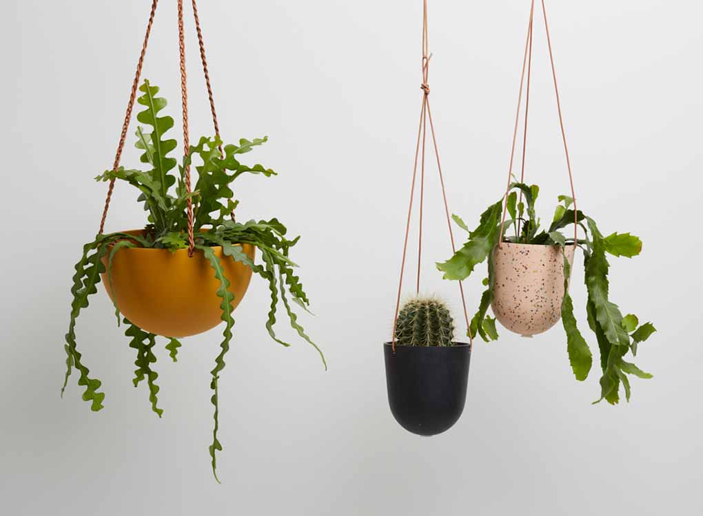 The SALT BLOCK COLOR DOME HANGING PLANTER IS SKILLFULLY HAND MADE FROM RESIN AND FINISHED WITH TAN LEATHER The planter has a hole in the bottom for drainage and a plug for convenience. Designed in Australia. Worldwide shipping. Free UK shipping.