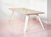 Puik Fold steel framed oak table on a pink tiled floor