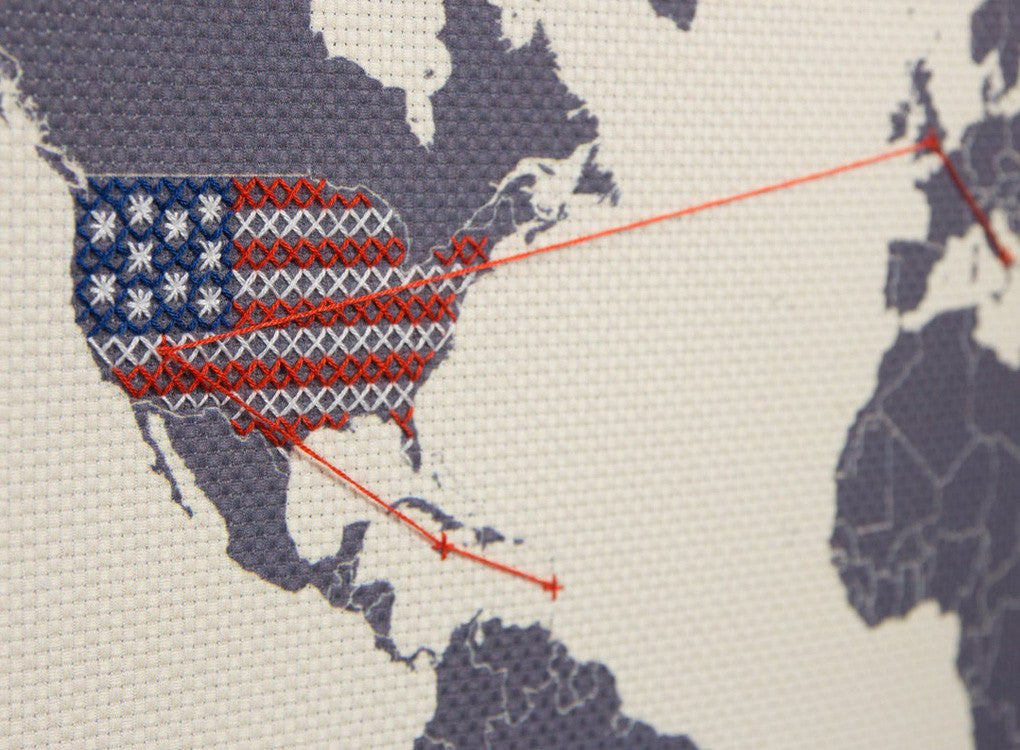 Getting creative with the cross stitching to create flags on the countries around the world
