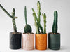 Range of Etch pots from Capra Designs. Hand-made plant pots inspired by Mid-century design in a range of contemporary colours.