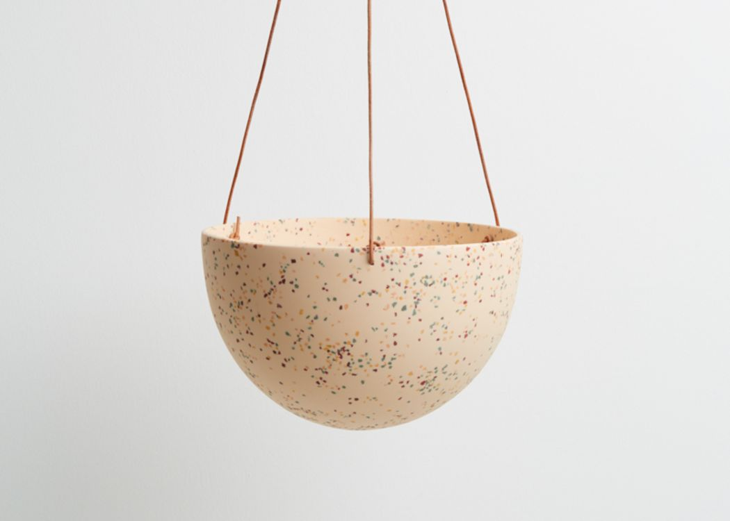 CAPRA DESIGNS SALT TERRAZZO DOME HANGING PLANTER IS SKILLFULLY HAND MADE FROM RESIN AND FINISHED WITH TAN LEATHER. Each planter has a hole in the bottom for drainage and a plug for convenience. Worldwide shipping. Free UK shipping.