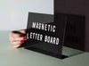 Sticking Magnetic Vynil Letters onto a black perforated steel letter board