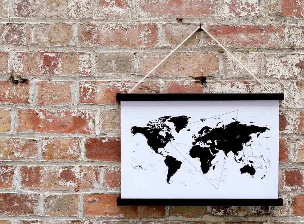 Contemporary world map framed art print hanging on a bring wall