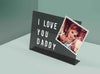 Magnetic desk message board showing an I love you daddy message with photograph included under the magnetic letters