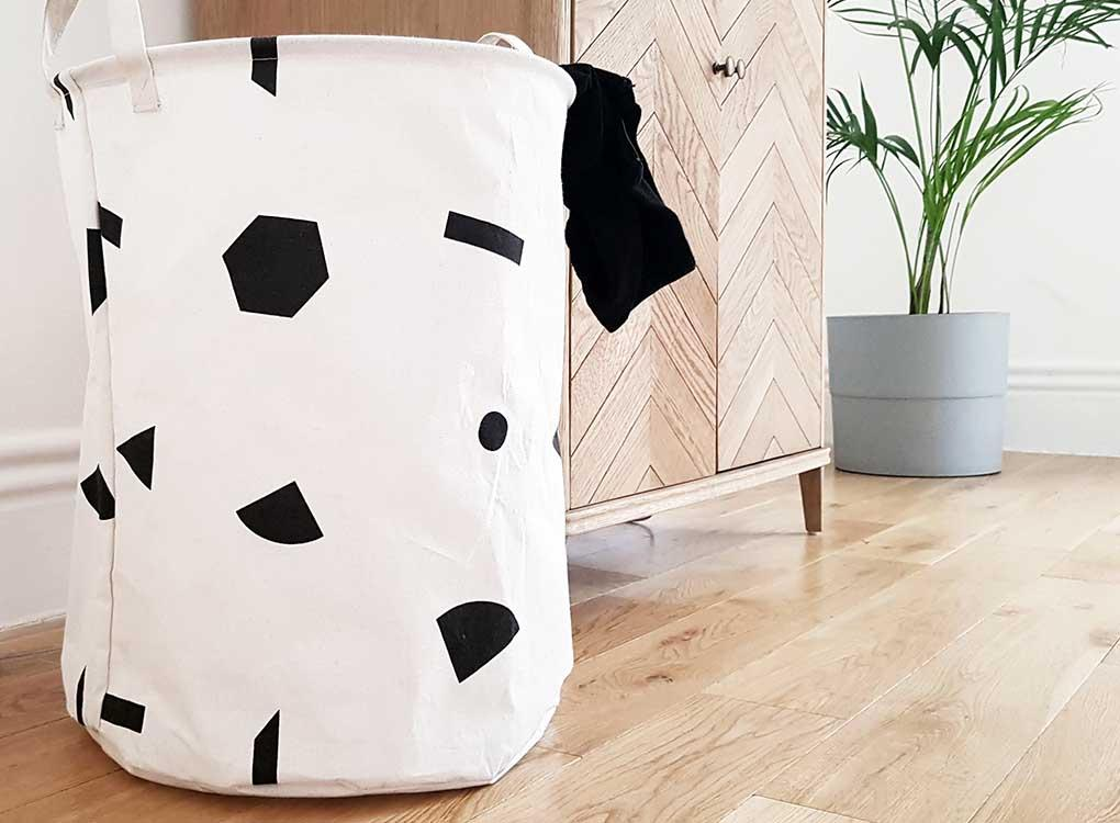 Contemporary laundry basket with black memphis shapes pattern