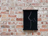 Nude Woman Life Drawing Art Print hanging in a Black Poster Frame on a Brick Wall