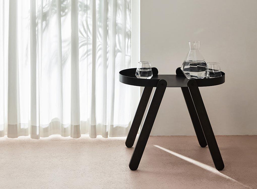 Stylish black Tepsi side table by Moxon London