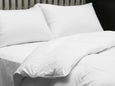 Dreamsong White Goose Down Duvet placed and folded on bed