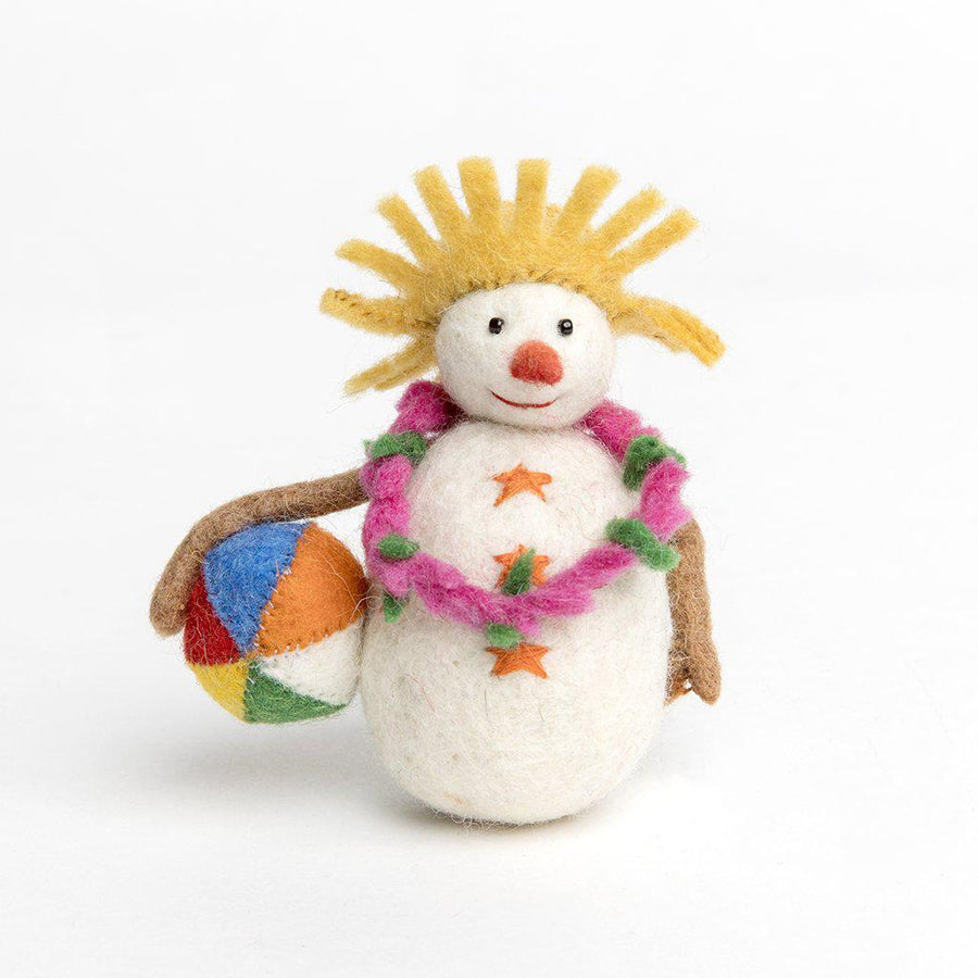 A handmade felt snowman ornament wearing a straw hat and pink flower lei holding a beachball.