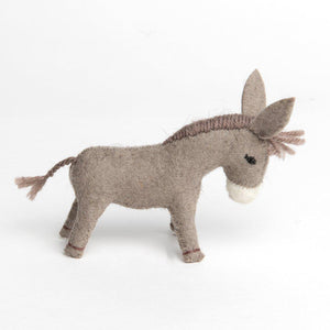 A handmade felt donkey ornament with large ears brown hair and a white muzzle