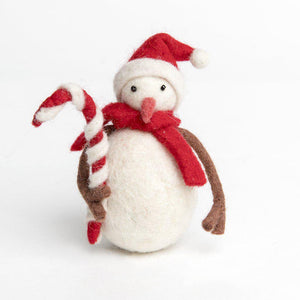 A Craftspring handmade snowman ornament wearing a red santa hat and a red scarf holding a large candy cane.