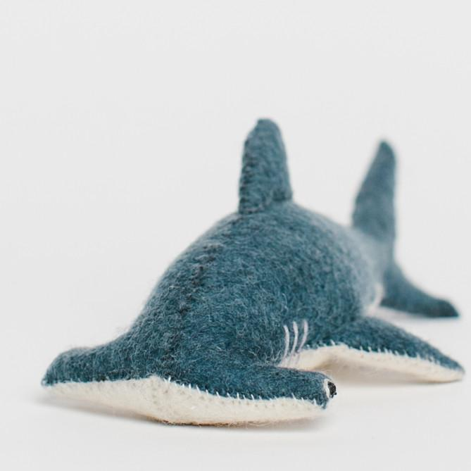 A Craftspring handmade felt hammerhead shark ornament with a blue body and white belly