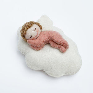 A Craftspring handmade felt baby fairy ornament sleeping on a cloud wearing a pink onesie