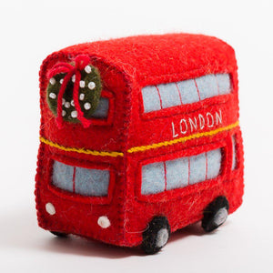 A Craftspring handmade red London bus felt ornament with a festive wreath