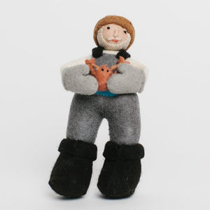 A craftspring handmade felt fisherman ornament with a white beard wearing grey overalls and black boots holding an orange crab