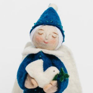 A Craftspring handmade felt frosted night angel wearing a blue dress and pointy hat and holding a small dove