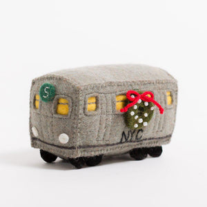A craftspring handmade felt number 5 subway train car with a festive wreath on the side