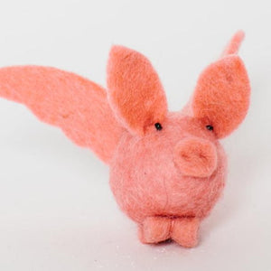 A Craftspring handmade pink felt pig ornament with pink wings
